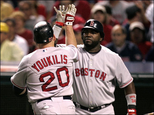 Kevin Youkilis (left) celebrated with David Ortiz (right) after Youkilis's home run in the first.