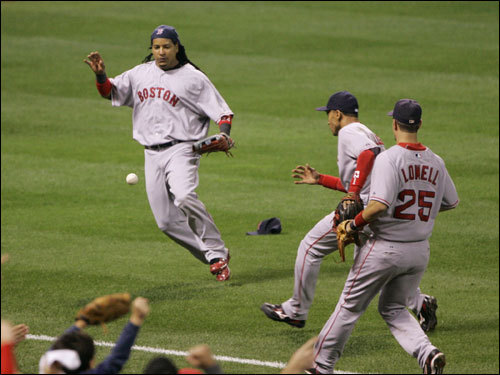 Manny Ramirez (left), Julio Lugo (center), and Mike Lowell (25) ran after a bloop that dropped in left field in the first inning.
