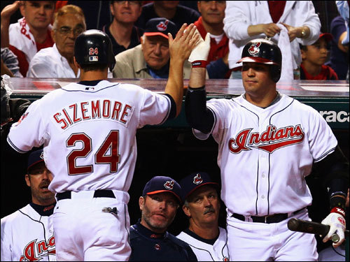 Grady Sizemore (left) celebrated with Victor Martinez (right) after scoring on a doubleplay in the first inning.