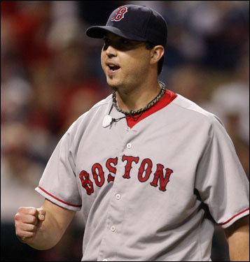 Josh Beckett reacted to striking out Casey Blake to end the seventh inning.