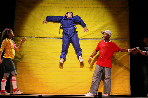 10-year-old Andrew Spada of Bernazzani Elementary School was suspended from a velcro wall during a science education concert called FMA Live! at North Quincy High School. FMA Live! is a traveling stage show that demonstrates science in children's everyday lives.