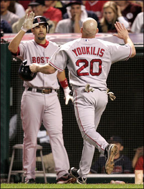 Kevin Youkilis was greeted by Mike Lowell after scoring in the 7th on a David Ortiz sacrifice fly.