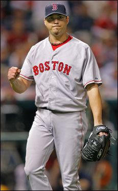 Red Sox starting pitcher Josh Beckett pumps his fist after getting the last out of the 8th, the last batter he would face.