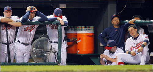 The Indians dugout sat dejectedly following the game.