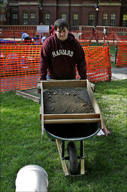 An archeological project led by Harvard University's Peabody Museum is attempting to find the remains of the Harvard Indian College, established in Harvard's earliest years. Student Adam Kaplan (left) wheeled a sieve screen toward a series of archeological holes dug in an attempt to find 17th century relics from the Indian College. In Harvard's earliest years, the Indian College was the only brick building on a campus now famous for brick.
