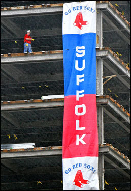 Suffolk Construction displayed a banner on an apartment building under construction on Boylston Street near Fenway.