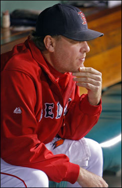 Curt Schilling sat on the bench before his start in Game 6 of the ALCS.