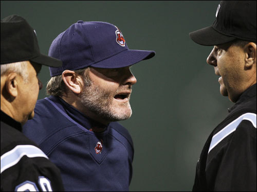 Indians manager Eric Wedge (center) argued with umpires after the close call.