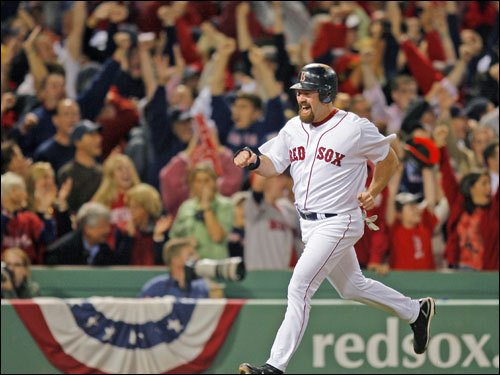 Kevin Youkilis ran to home plate as fans cheered on the third base line.