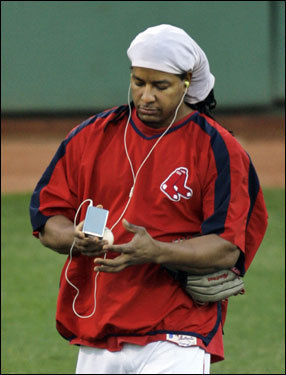 Red Sox outfielder Manny Ramirez walked the field during pregame warmups.