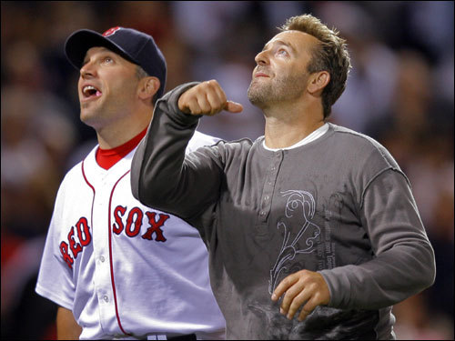 Doug Mirabelli (left) and Kevin Millar (right) walked off the field after the ceremonial first pitch.