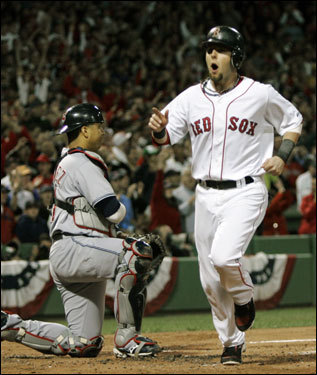 Dustin Pedroia crossed the plate after scoring on a Manny Ramirez single in the first inning.