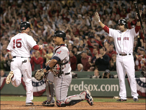 Dustin Pedrioa (left) crossed the plate as Mike Lowell (right) held his hands up so Pedroia wouldn't slide.
