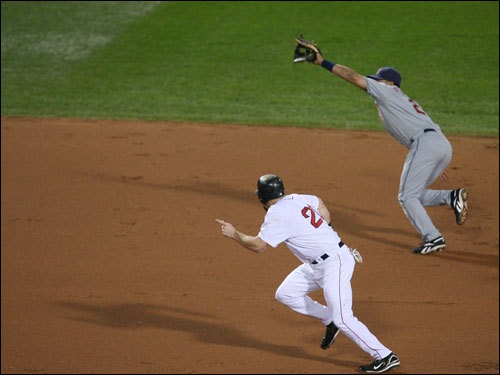 Kevin Youkilis (bottom) ran to third as Jhonny Peralta (top) couldn't glove a single by Manny Ramirez in the first inning.