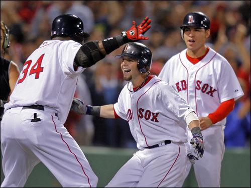 David Ortiz (left), Dustin Pedroia (center), and Jacoby Ellsbury (right) celebrated Pedroia's seventh inning home run.