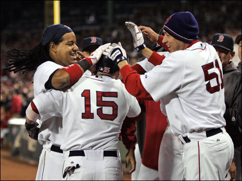 Dustin Pedroia (15) was mobbed at the steps of the dugout after his two-run home run.