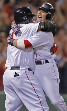 David Ortiz (left) hugged Dustin Pedroia (right) after Pedroia crossed the plate in the seventh inning.