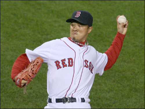Hideki Okajima gave up two consecutive hits to start the eighth inning before being pulled.