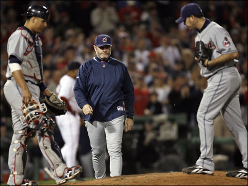 After allowing three runs to score in the eighth, Rafael Betancourt (right) was pulled by Indians manager Eric Wedge (center).
