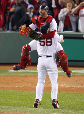 Jason Varitek and Jonathan Papelbon (58) celebrated the Red Sox winning the AL pennant.