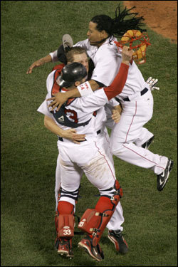 Manny Ramirez (right) joined the celebration on the mound after the victory.