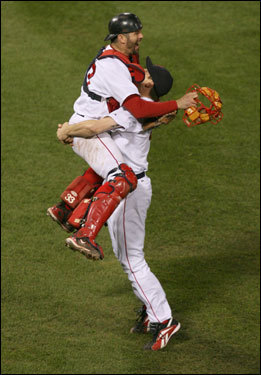 Red Sox catcher Jason Varitek (right) jumped into the arms of Jonathan Papelbon after the final out of the ninth inning.
