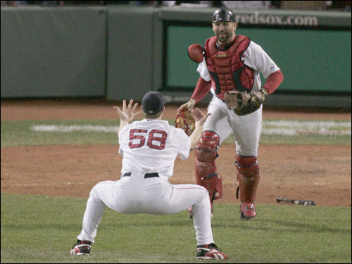 Red Sox closer Jonathan Papelbon held out his arms for Jason Varitek after clinching a spot in the World Series.