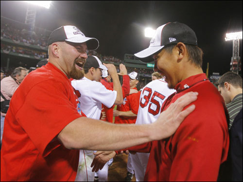 Kevin Youkilis (left) and Game 7 winning pitcher Daisuke Matsuzaka celebrated on the field.