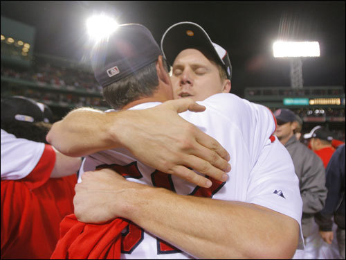Jonathan Papelbon (right) and Red Sox pitching coach John Farrell (left) hugged during the celebration.