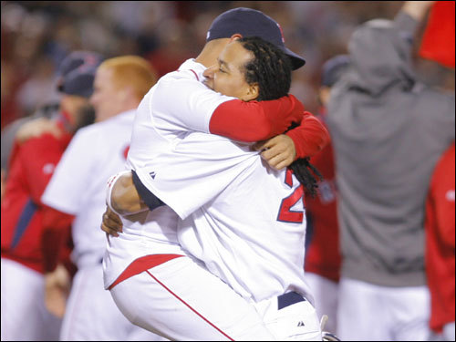 Manny Ramirez (right) and Julio Lugo hugged on the field during the celebration.