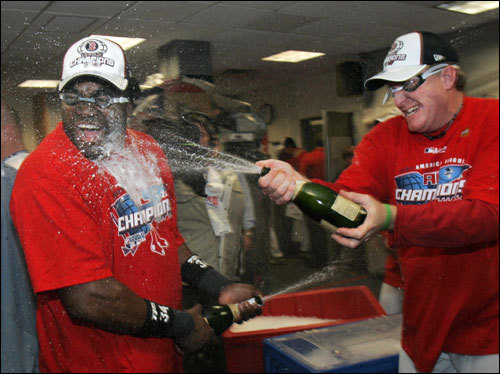 David Ortiz (left) was sprayed with champagne by Curt Schilling during celebrations.