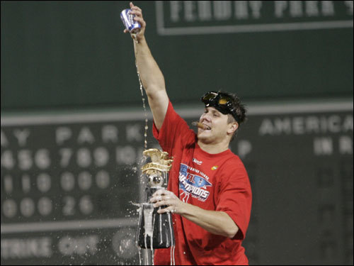 Jonathan Papelbon doused the American League Championship trophy with beer on the field during celebrations.