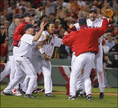 The Sox rushed the field after the final out of Game 7.