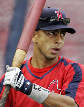 Red Sox shortstop Julio Lugo waits to hit during batting practice at Fenway Park on Tuesday.