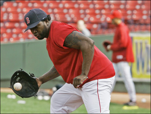 David Ortiz took some ground balls at first base during Tuesday's workouts in preparation for Games 3, 4, and 5 in Colorado, where they'll play without a designated hitter.