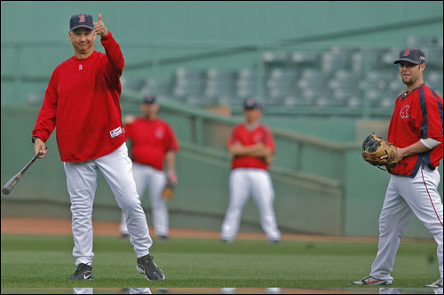 Red Sox manger gave a thumbs up during batting practice Tuesday at Fenway Park. He could be giving it to second baseman Dustin Pedroia (right) for his recent play.