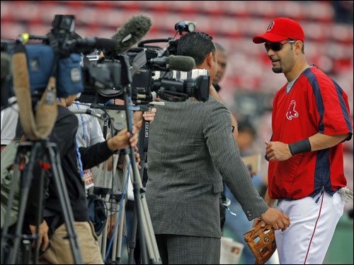 Red Sox 3B Mike Lowelll did an interview with former Red Sox infielder Carlos Baerga.