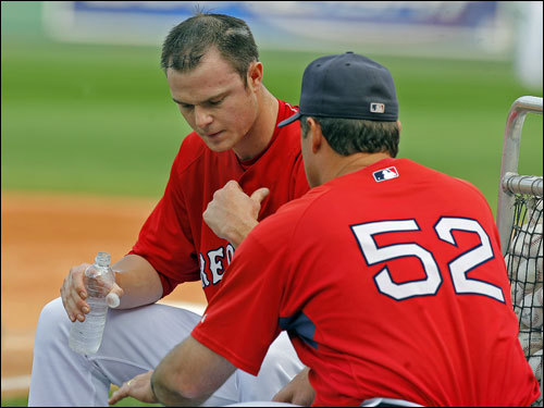 After his simulated game, Jon Lester (left) talked with pitching coach John Farrell.