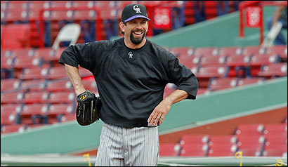 Rockies first baseman Todd Helton gets more recognition when he has a bat in his hands, but he's just as comfortable wearing a glove, as evidenced at yesterday's workout.