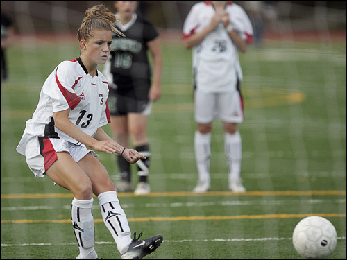 Whitman-Hanson midfielder Kristie Mewis (13) looks up to her penalty shot heading into the net.