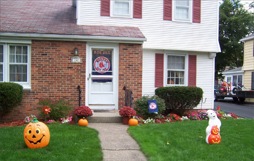Joe Waltz of Rochester, N.Y., flies the Red Sox colors at his house even though he's in Evil Empire territory.