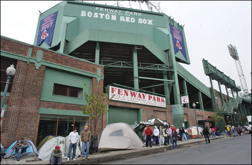 Boston Red Sox fans wait in line for vouchers for tickets to Game 1 of the World Series.