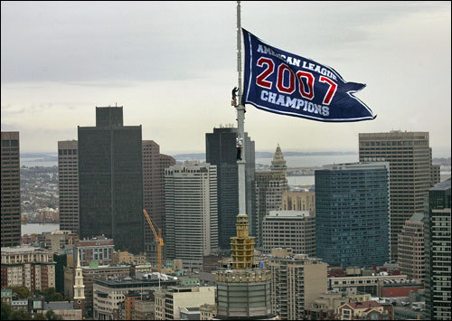 The American League Championship banner flies above the old John Hancock tower.