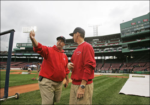 Head groundskeeper Dave Mellor (left) talks to Mike Sweeney as they prepare the field for Game 1 of the World Series at Fenway Park. Mellor dreamed of making it to the major leagues the regular way before a car crash nearly killed him.