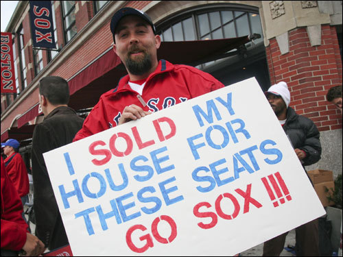 Eric Mosher bought two $950 tickets for Wednesday night's World Series Game 1 to sit near the Pesky Pole. He said that his sign was no joke - 'I've missed a couple mortgage payments for these tickets.'
