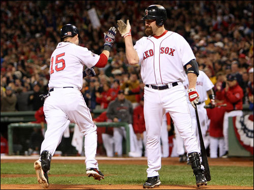 Dustin Pedroia (15) and Kevin Youkilis (right) celebrated at home plate.