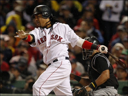 Manny Ramirez swung at the first pitch and lined an RBI single into left field, giving the Red Sox a 2-0 lead in the first inning.