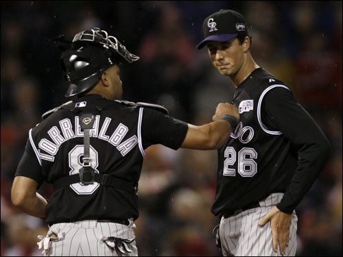 Rockies starter Jeff Francis (right) met with catcher Yorvit Torrealba (left) after struggling in the first inning.