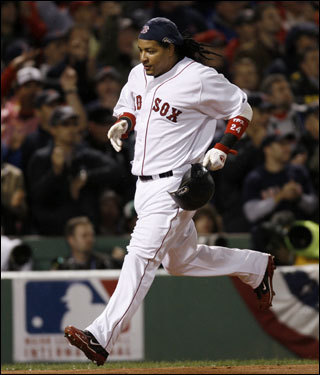 Manny Ramirez crossed the plate on a double off the bat of J.D. Drew (not pictured) in the first inning.