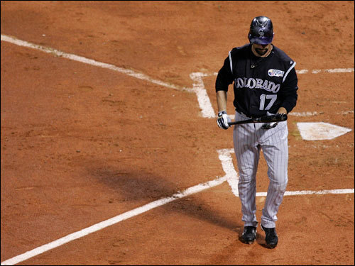 Todd Helton walked back to the dugout after striking out to begin the second inning.